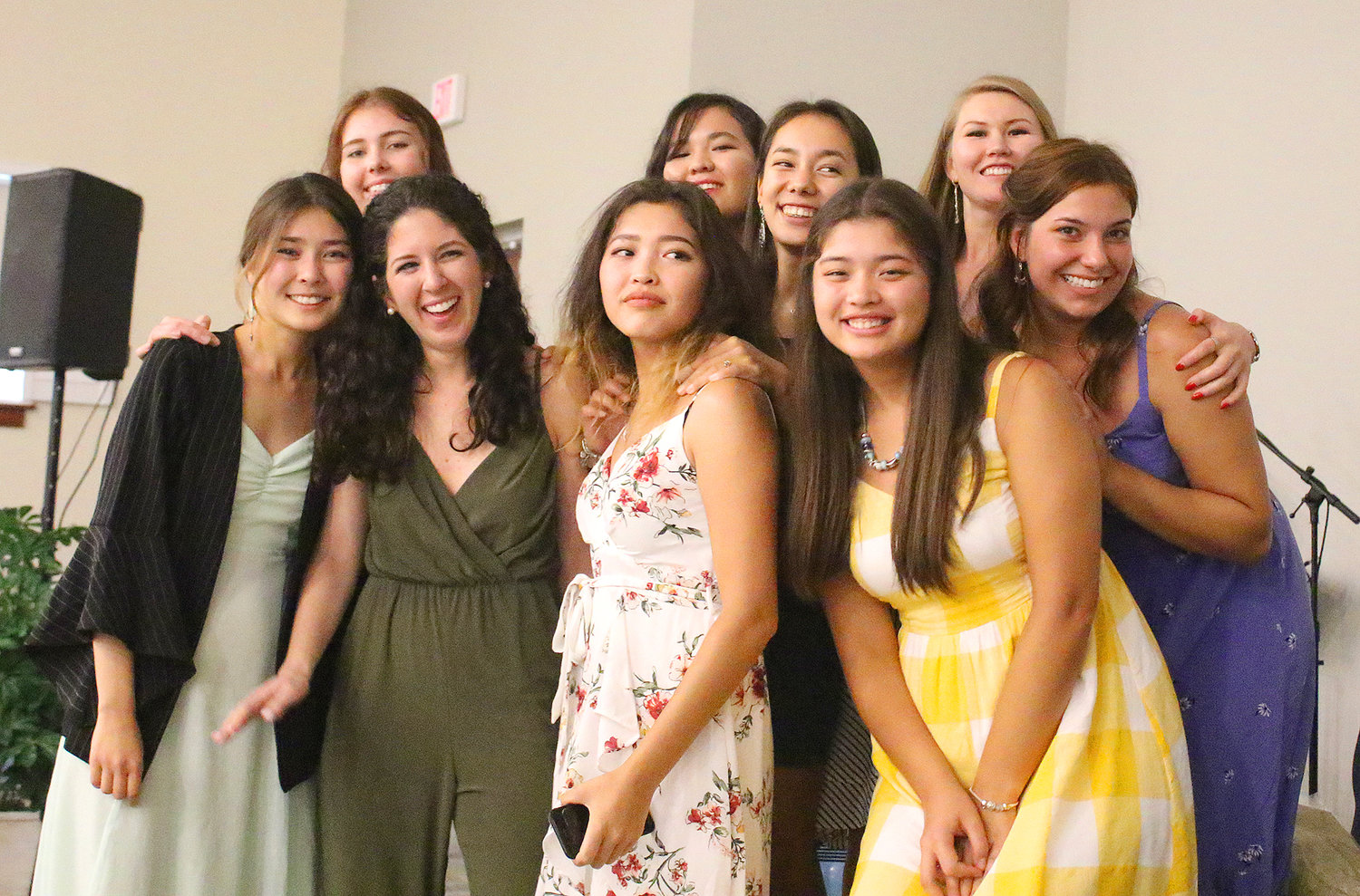 Eight young women from Kazakhstan pose with The Greatest Exchange founder, Kelly Ray, during the Night of Celebration  at Waypoint Church at Nocatee on Aug. 9.