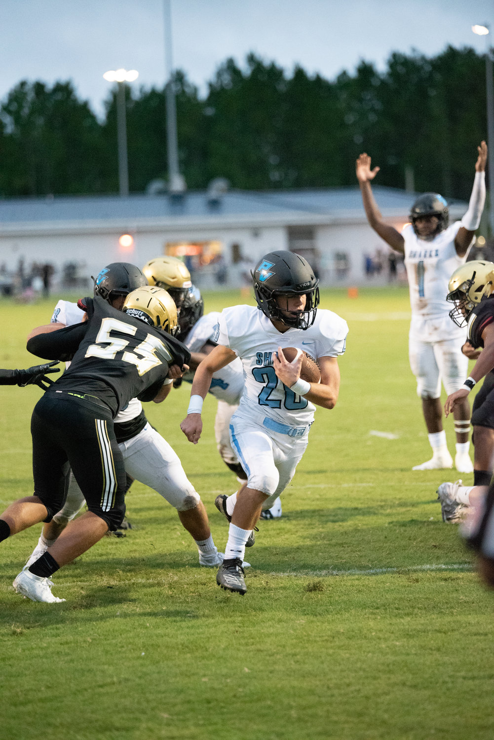 A Sharks defender tackles an Oakleaf player during the preseason scrimmage.