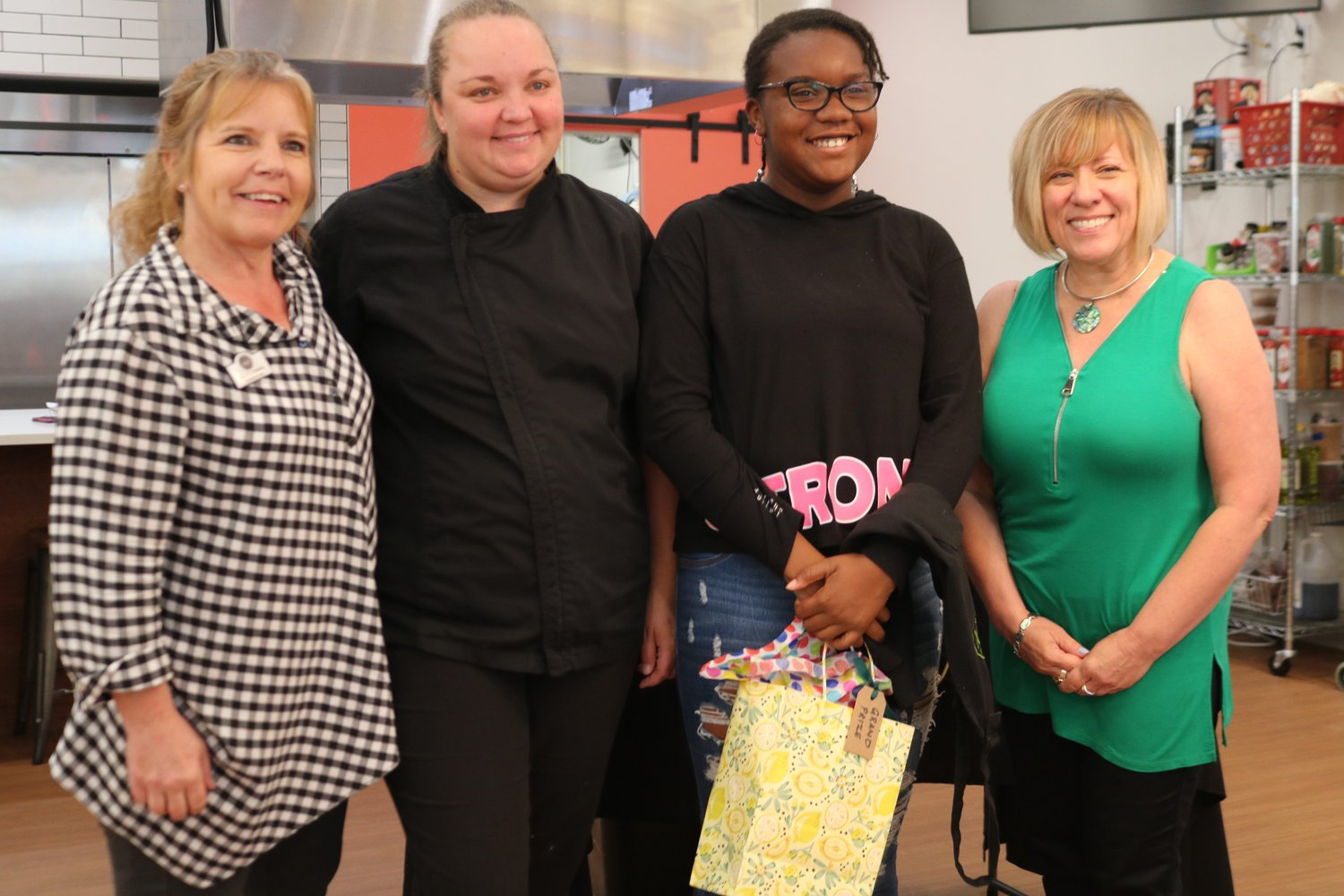 Judges and Chefs (left to right) Nancy Slatsky, Verousce McKibbin and Nancy Guarnieri pose with Cupcake Contest winner, Symphony Brown, who baked triple chocolate cupcakes.