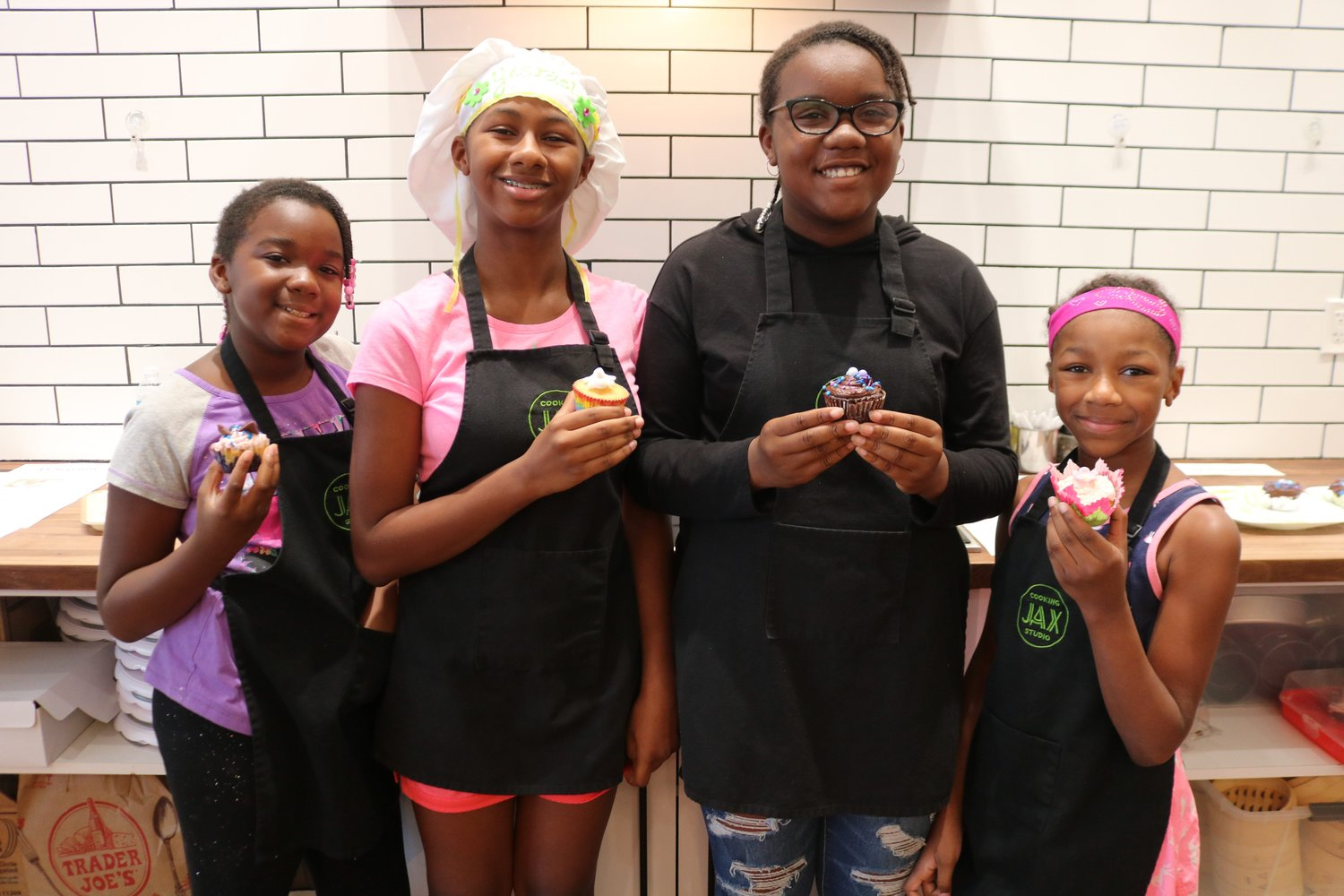 It was a family affair at the competition as siblings, cousins and contestants (left to right) Serenity Brown, Yisrael Washington, Symphony Brown and Amani Washington pose with their cupcakes after the contest.