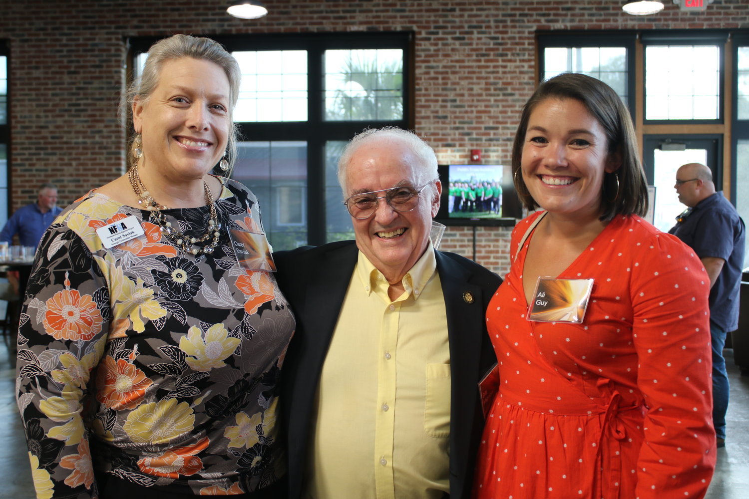 Carol Saviak, strategic partnerships manager at St. Augustine-St. Johns County Airport Authority, Bill Mignon, St. Johns County School Board member, and Ali Guy, account manager at Design Extensions, stop to pose for a photo at the United Way-SJC event.