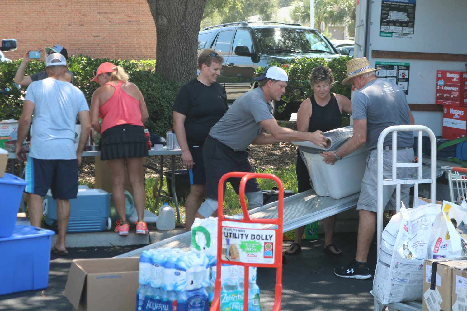 Volunteers help stocking up the UHaul trucks located at Winn-Dixie off Solana Road and A1A.