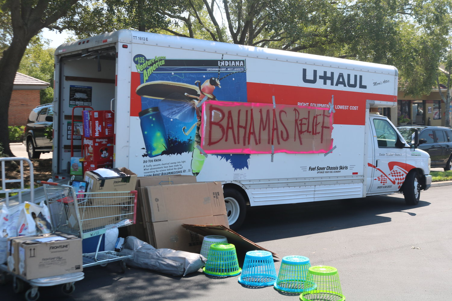 Multiple UHaul trucks rented by Mignone are filling up with supplies donated by Ponte Vedra residents.