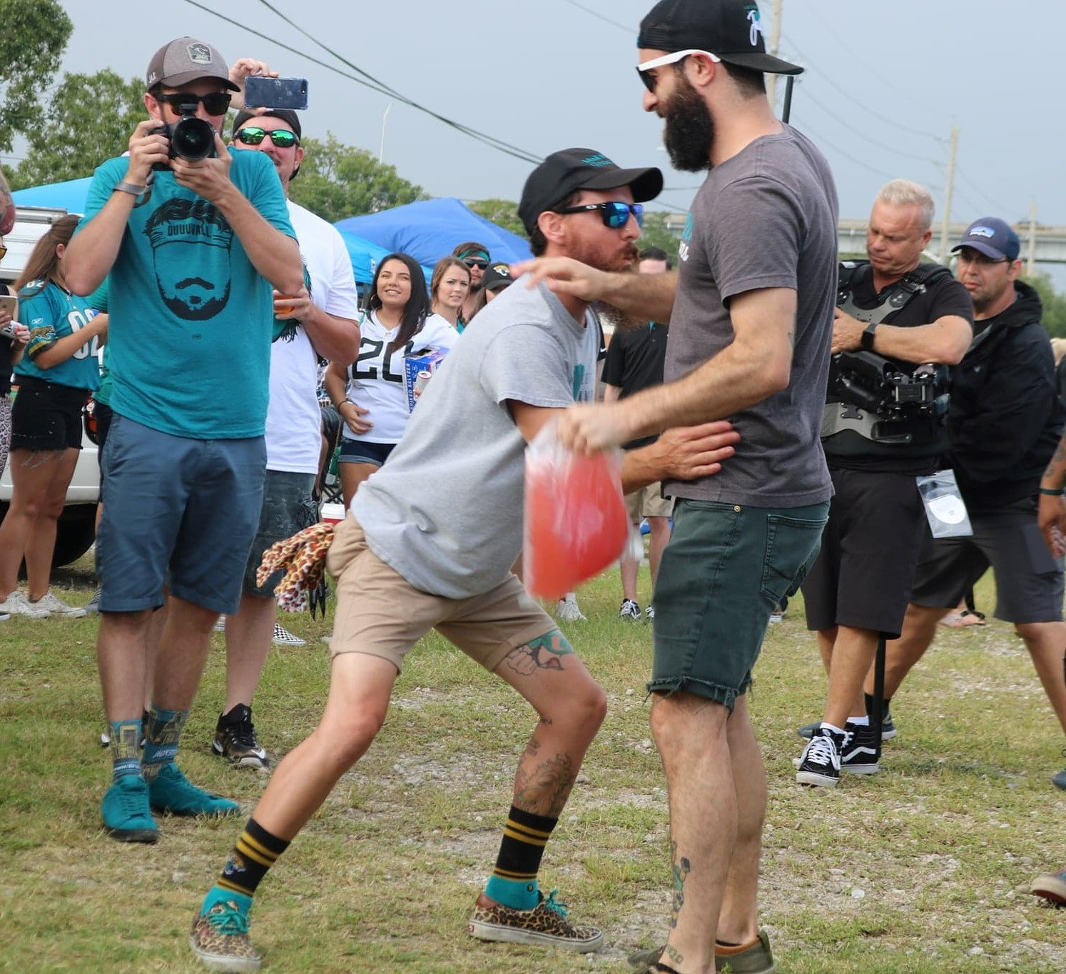 "Teal Street Hooligan, Matt Moses, attempts to ""slap the bag"" for good luck, but accidentally slapped Teal Street Hooligans co founder, Alex Varian, instead. Still no flag on the play."