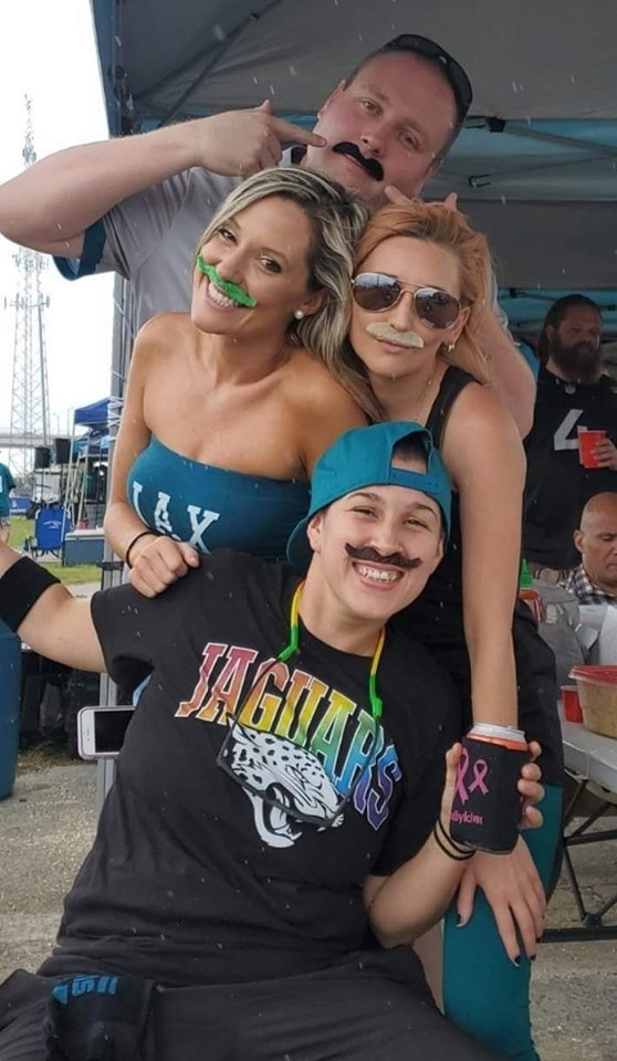 Jaguars fans and Hooligans (from top to bottom), Kevin Sigmund, Allison Batey, Crystal Crawford and Ashley Loza, pose in Minshew mustaches before the Thursday night game.