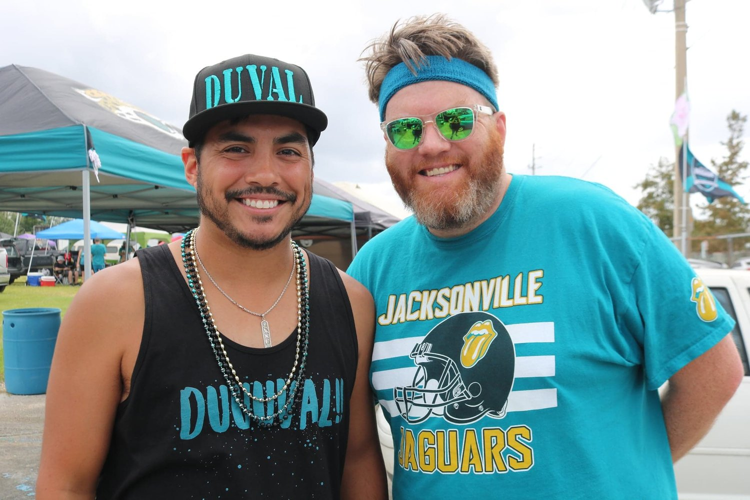 Fans (left to right), James Hamilton and Steve Krajewski, pose for the camera with Krajewski wearing his teal sweatband in support of Minshew II.