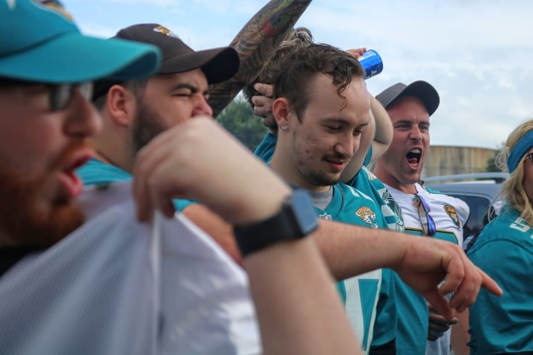 Jaguars fans put on their game faces for the camera to cheer on national TV.