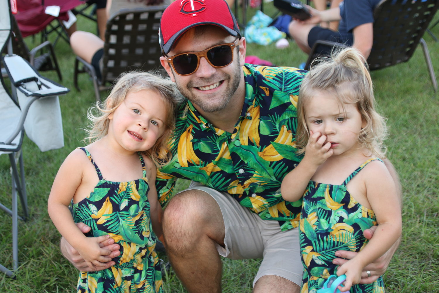 Identical twins Calla and Rynn attended Food Truck Friday with their father, Bradley Chard (center).