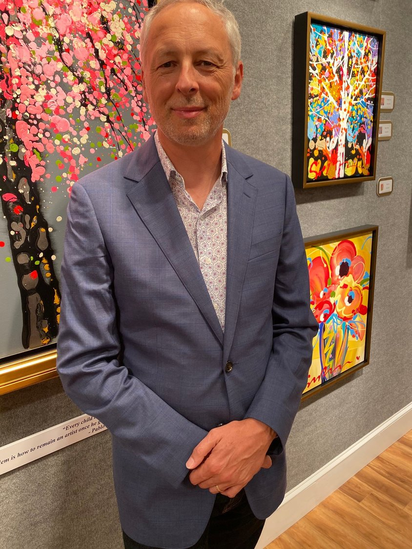 Simon Bull stands in front of one of his paintings on exhibit at Cutter & Cutter Fine Art in Ponte Vedra Beach.