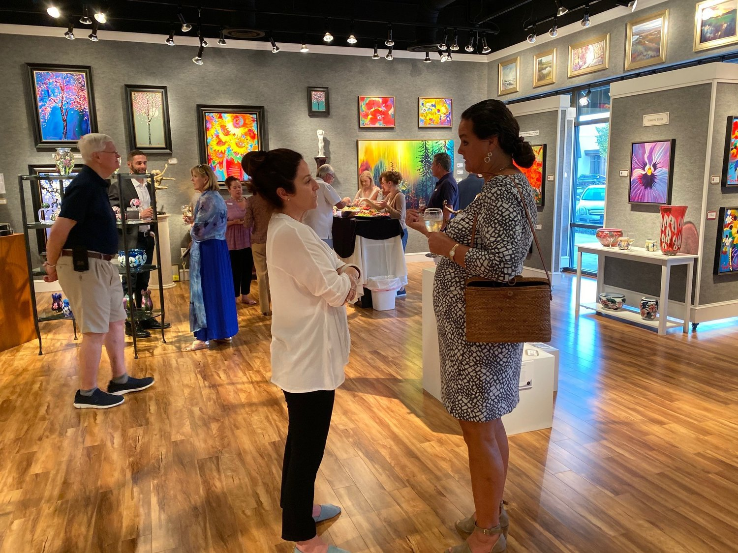Art lovers attend the Simon Bull exhibition Oct. 11 at Cutter & Cutter Fine Art in Ponte Vedra Beach.