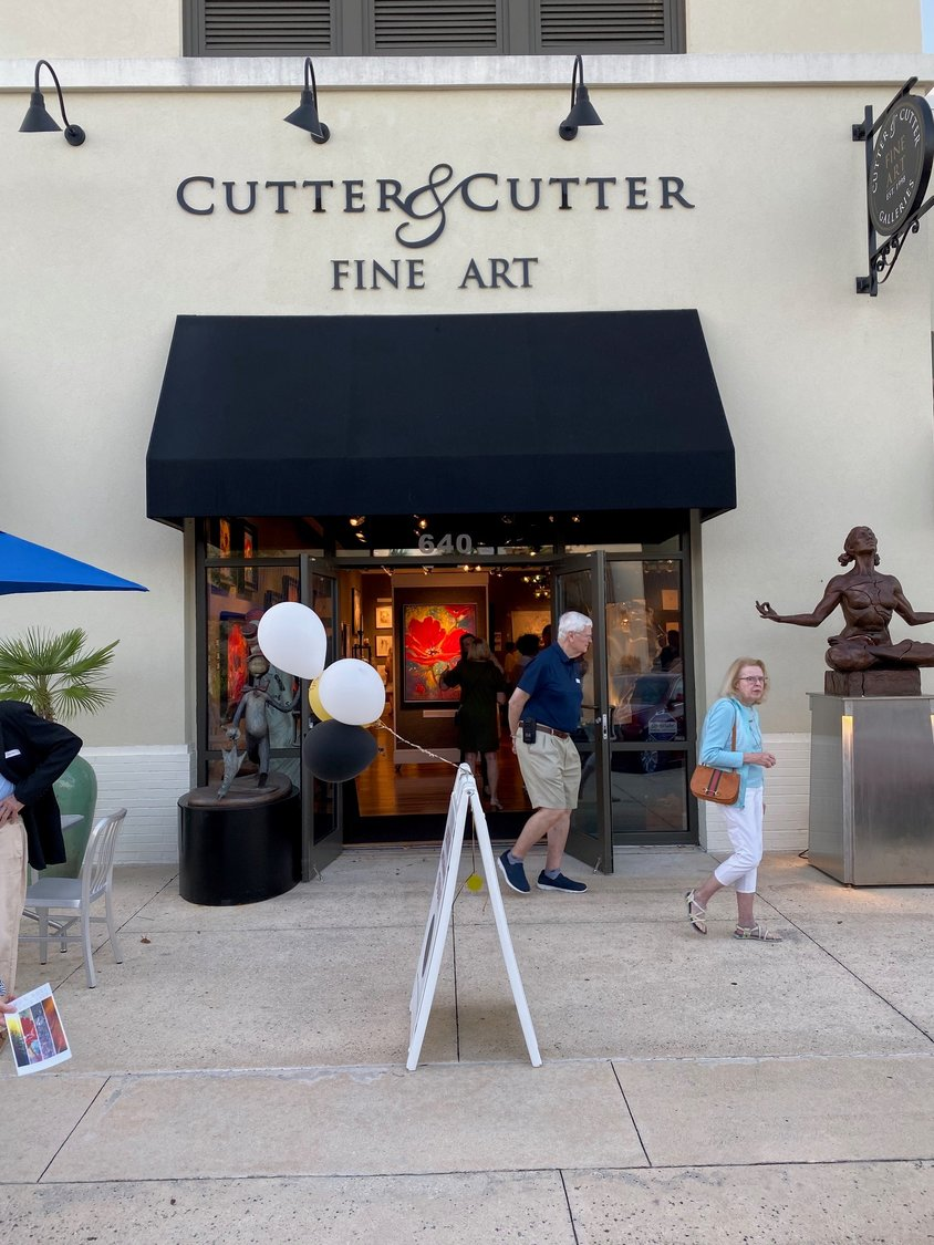 People attend the Simon Bull exhibition Oct. 11 at Cutter & Cutter Fine Art in Ponte Vedra Beach.