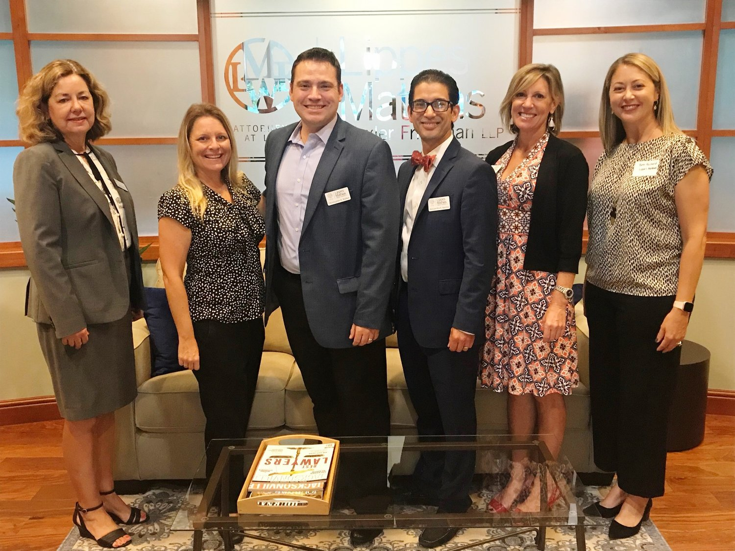 ) Karen Bourque Everett, Erika Hamer, Christopher Walker, Alessandro Apolito, Shannon M. Peabody and Bethany Reichard pose for a photo at the Chamber Before Hours event at Lippes Matthias Wexler Friedman LLP.