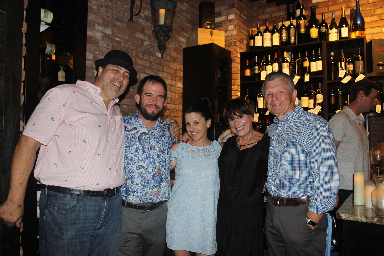 1.	(Left to right) Chef Jody Petronella poses with Coastal Wine Market owners, Steve and Shaun Lourie, and guests, Shirley and Dennis Mahoney.