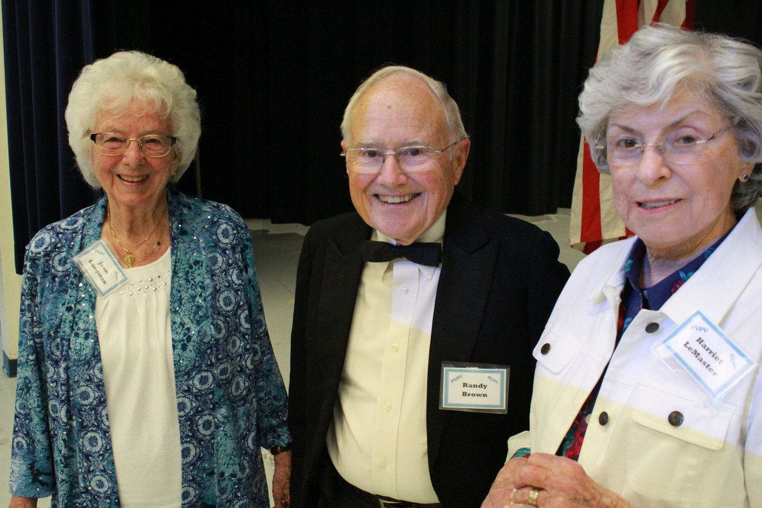 Jean Landrum Langston, Randy Brown and Harriet LeMaster gather at the 60th anniversary celebration of PVPV/Rawlings Elementary School on Friday, Feb. 22.