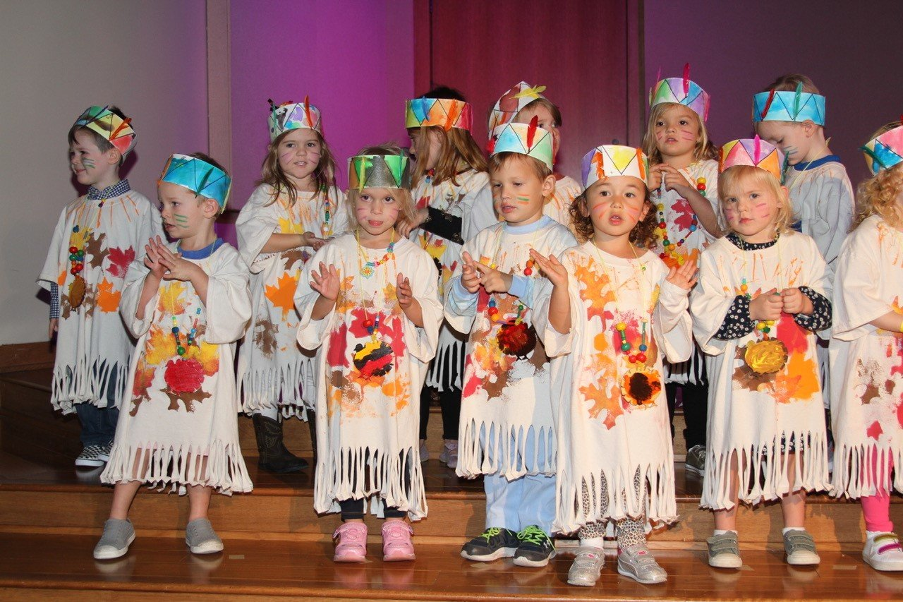Three-year-old students at the school sing a medley of songs.