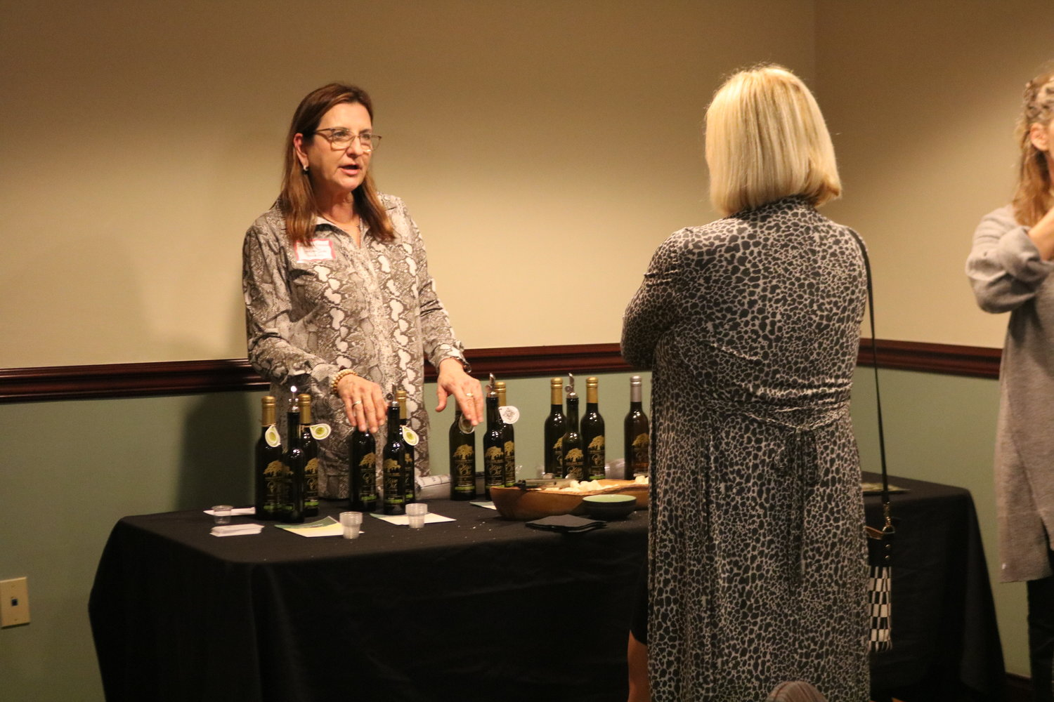5.	Donna MacPherson explains the different types of olive oils of her Golden Isles business in St. Simons Island, Georgia.