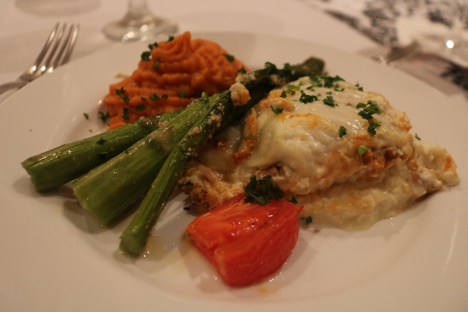8.	A Fall-inspired pumpkin lasagna was served to guests, with a side of carrot, sweet-potato mash and roasted tomato halves.