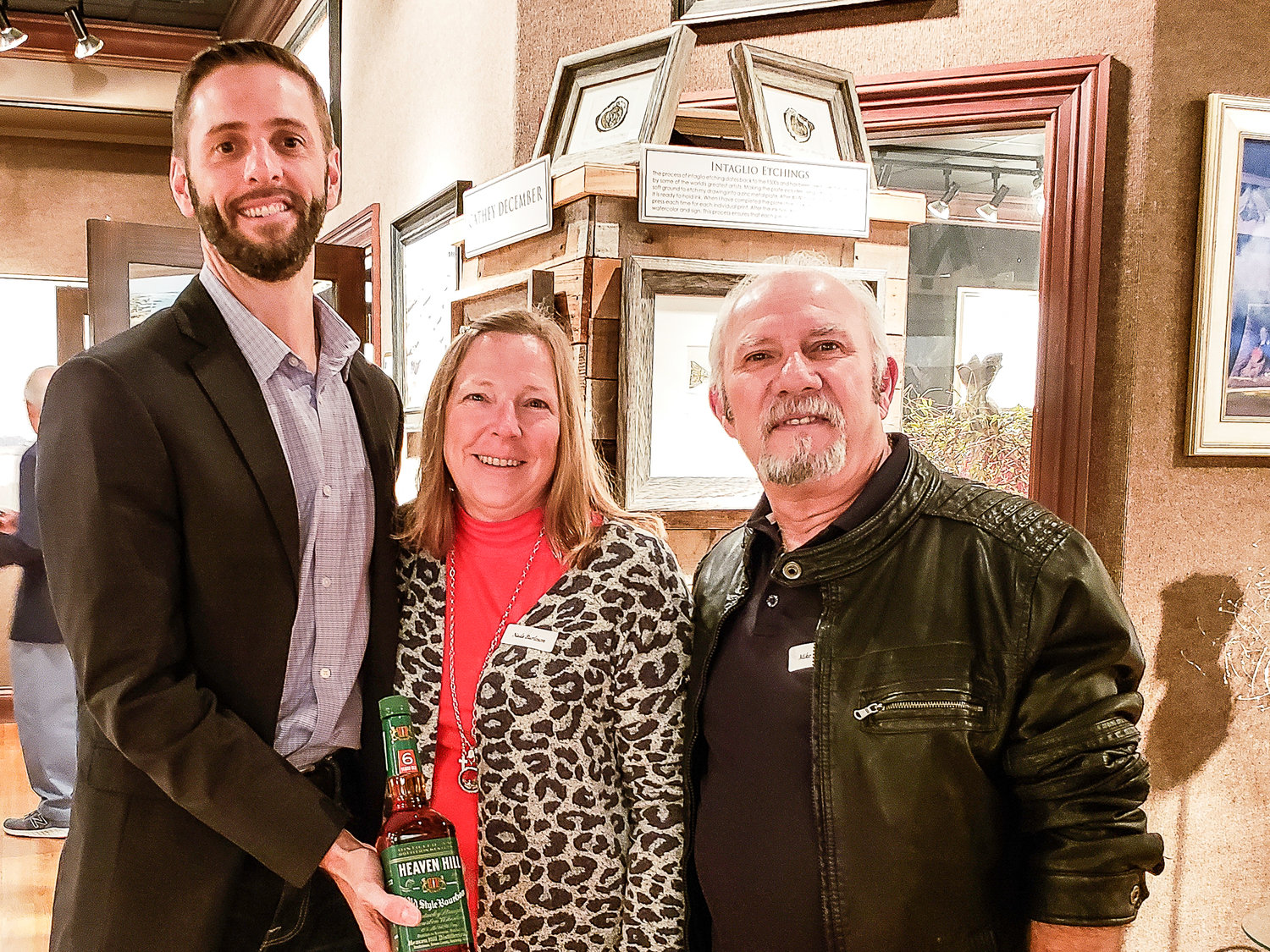 Nada and Michael Burleson met local artist Matthew Cutter, far left, about three years ago and began collecting his work. The couple  attended the Dec. 6, 2019 artist's reception at Cutter & Cutter Fine Art in St. Augustine.