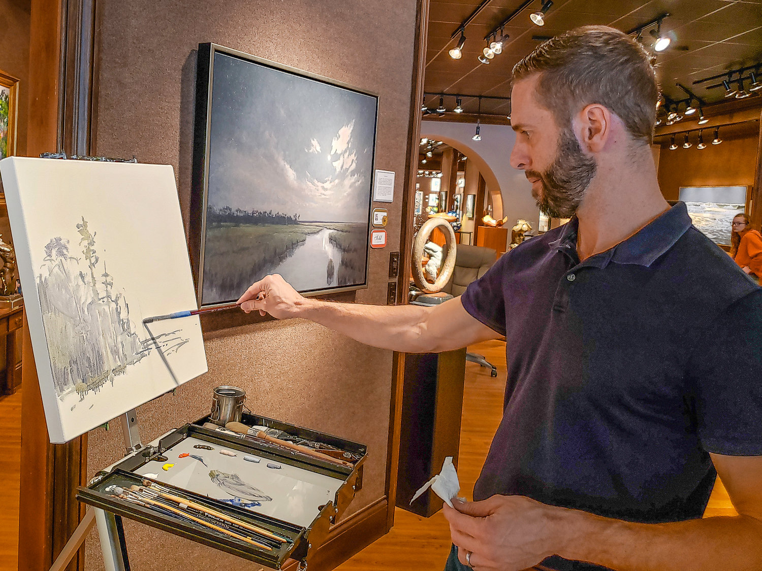 "Artist Matthew Cutter gives a live painting demonstration at Cutter & Cutter Fine Art Gallery in St. Augustine on Dec. 7, 2019. ""It's pretty fun to paint in front of people,"" Cutter said."