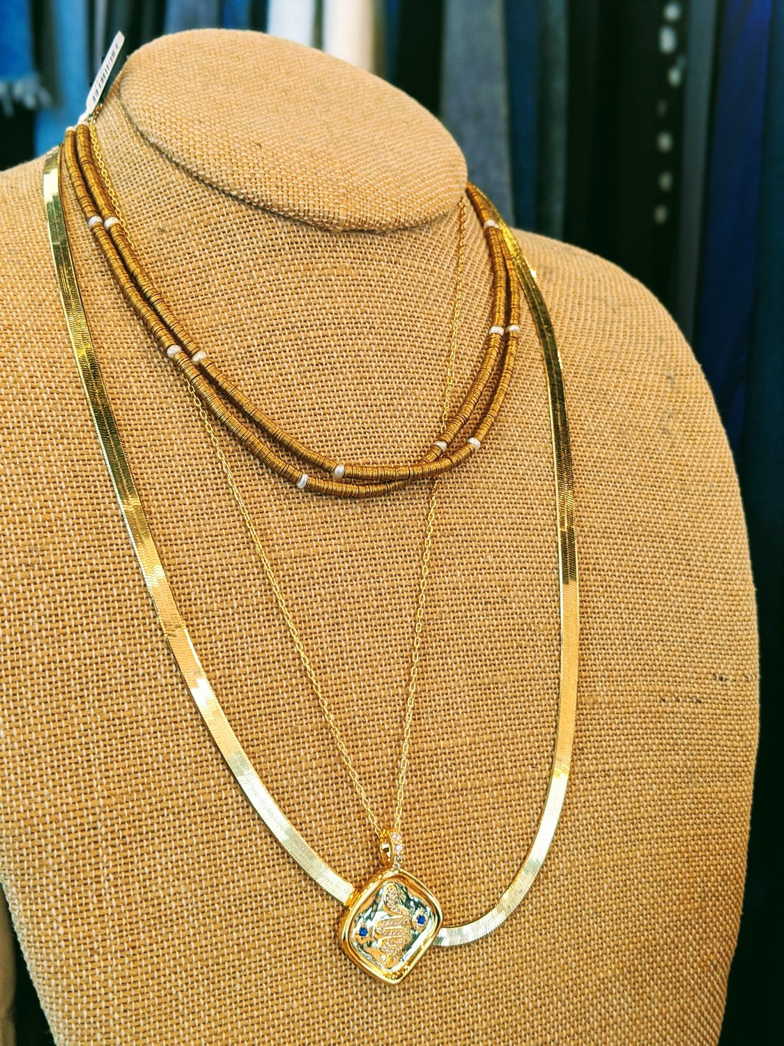 4-	Assorted gold necklaces by Serefina at Penelope T