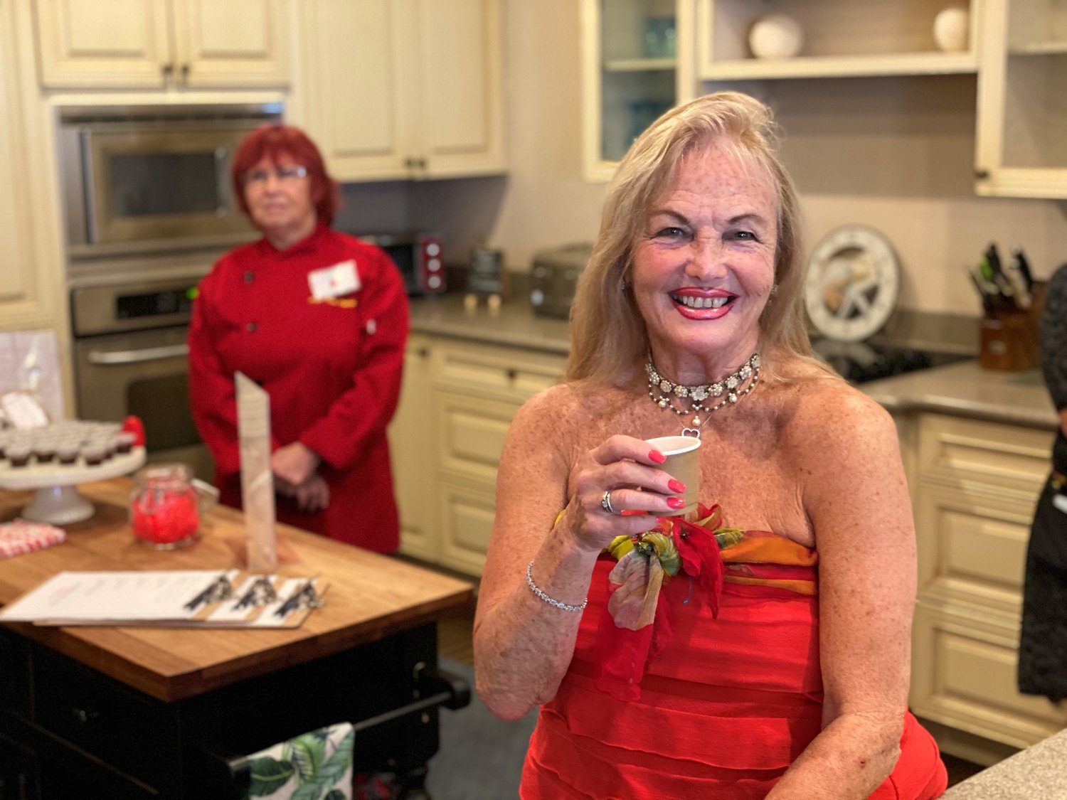 1-	Leigh Cort, Womens Food Alliance founder and president at the Feb. 26 tea