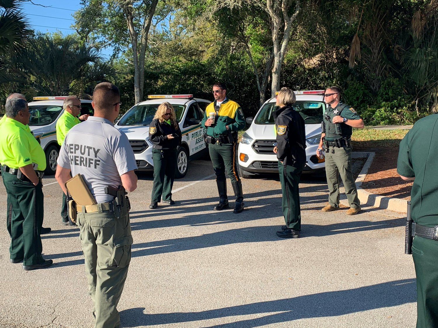 Deputies and Public Service Assistants meet outside in an abundance of caution for COVID-19 and to take advantage of perfect springtime weather before the start of another shift.