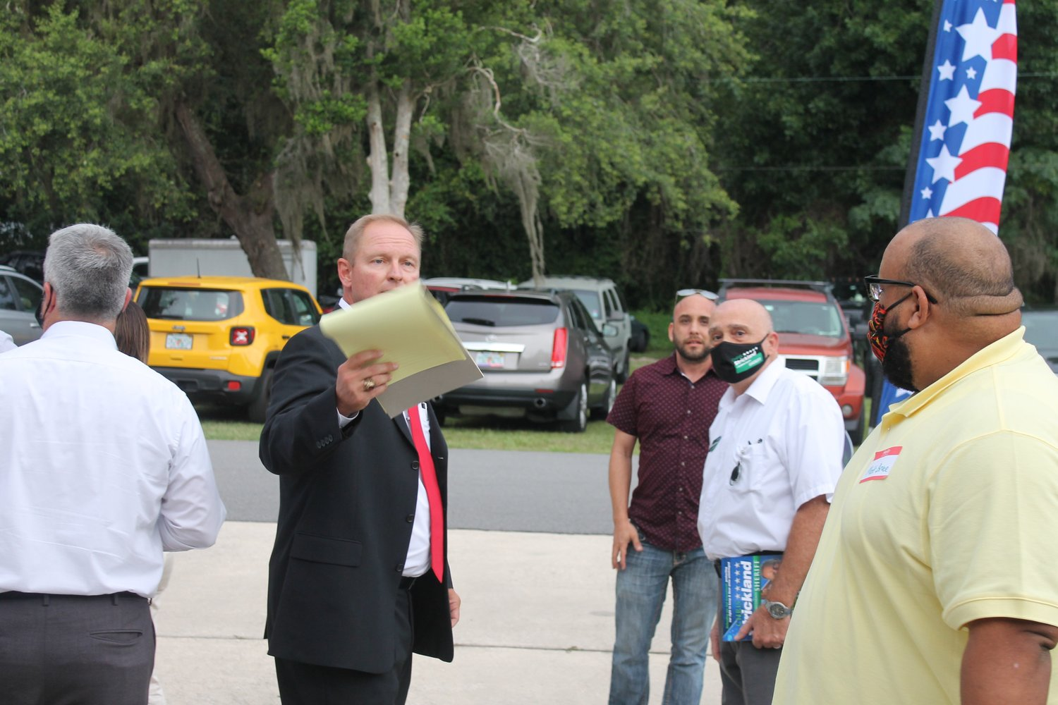 St. Johns County sheriff candidate Chris Strickland leaves the debate with Rob Hardwick early after an argument broke out between Sheriff David Shoar and Strickland supporters July 16 at the ShrIne Club in St. Augustine.