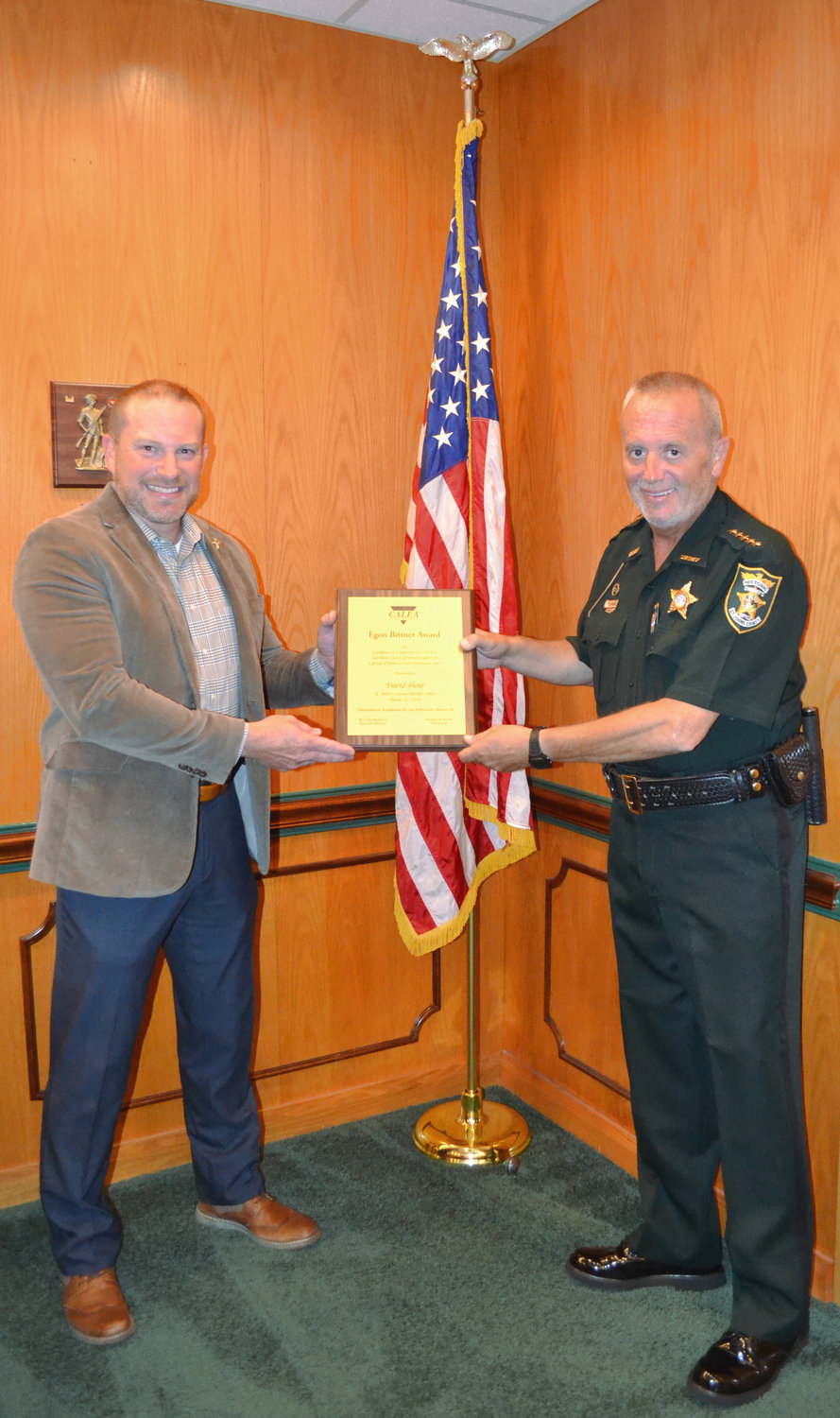 SJSO Director Jason Sheffield (left) presents the Bittner Award to St. Johns County Sheriff David Shoar.