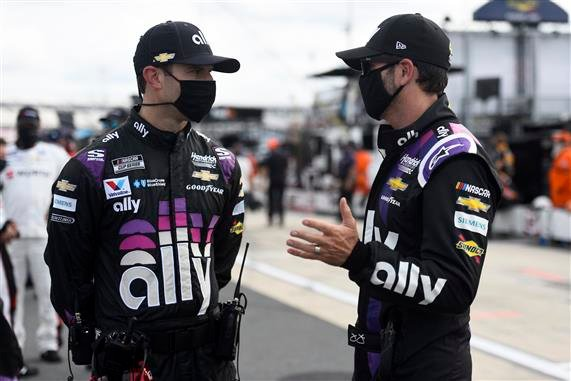 Crew chief Cliff Daniels, left, and Jimmie Johnson talk before last weekend's race at Dover, Delaware.