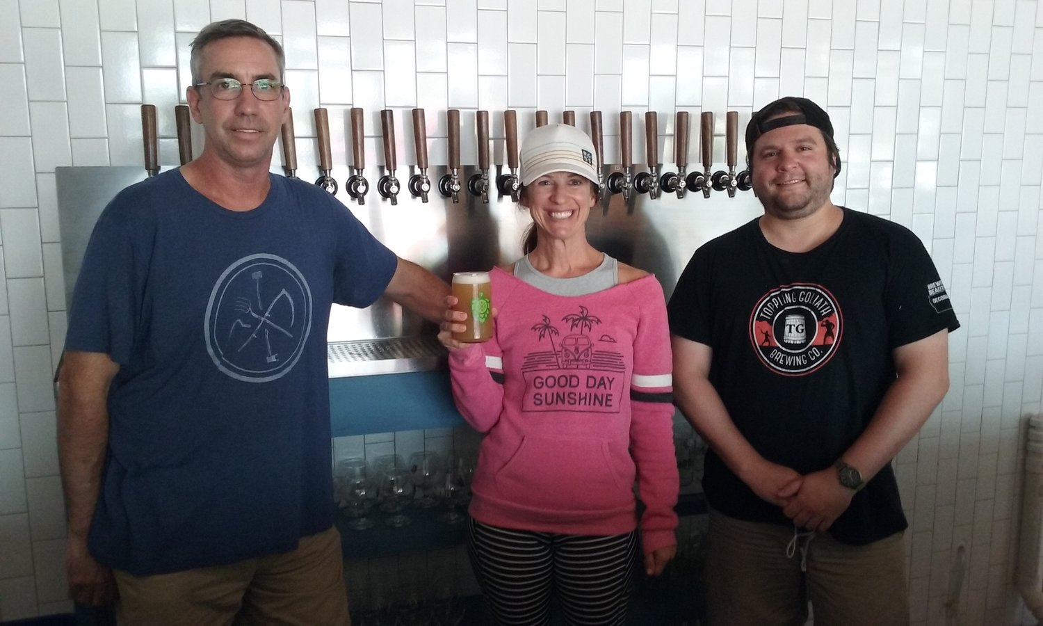 Really Good Beer Stop, a craft beer tap room, has opened in Nocatee Town Center. Pictured from left are Bob Van Scoy, co-owner Angie Brack and Riley McKelvie. Not pictured: co-owner Tim Brack.