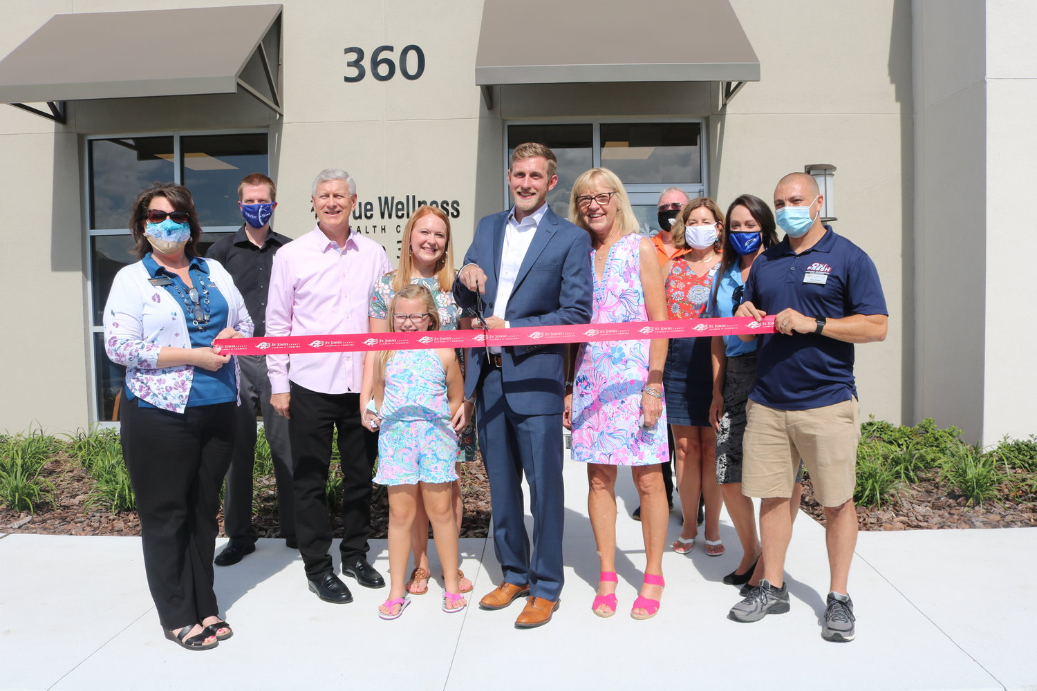 Dr. Ryan Heinz, center, with family and staff members, cuts the ribbon to celebrate the opening of True Wellness Health Center in the Nocatee Town Center on Thursday, Aug. 27