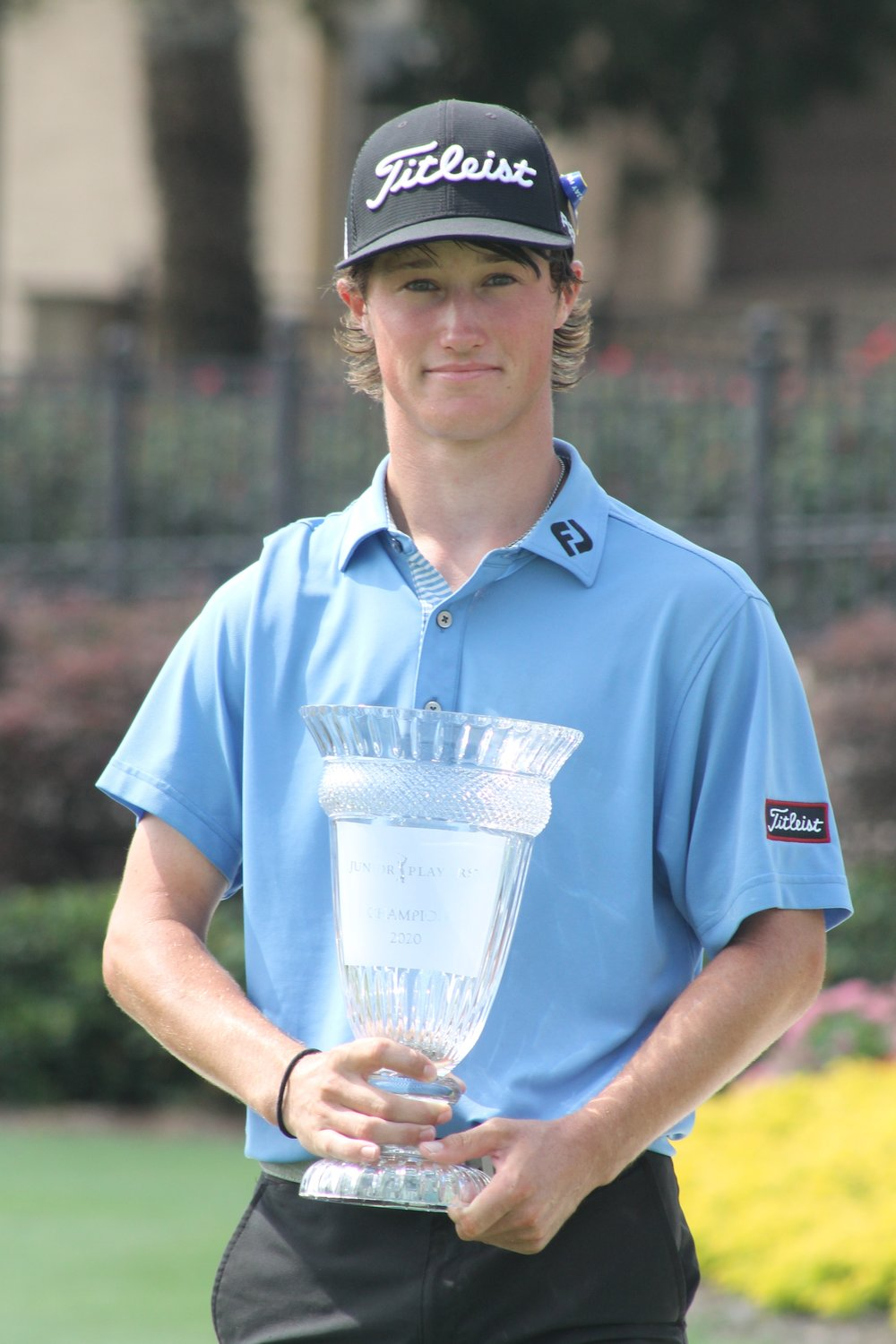 David Ford holds the trophy after winning the Junior PLAYERS Championship.