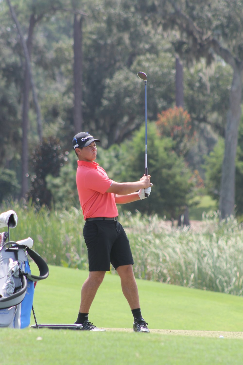 Karl Vilips hits a shot during Sunday's round.  Vilips was one of five players to tie for second place.