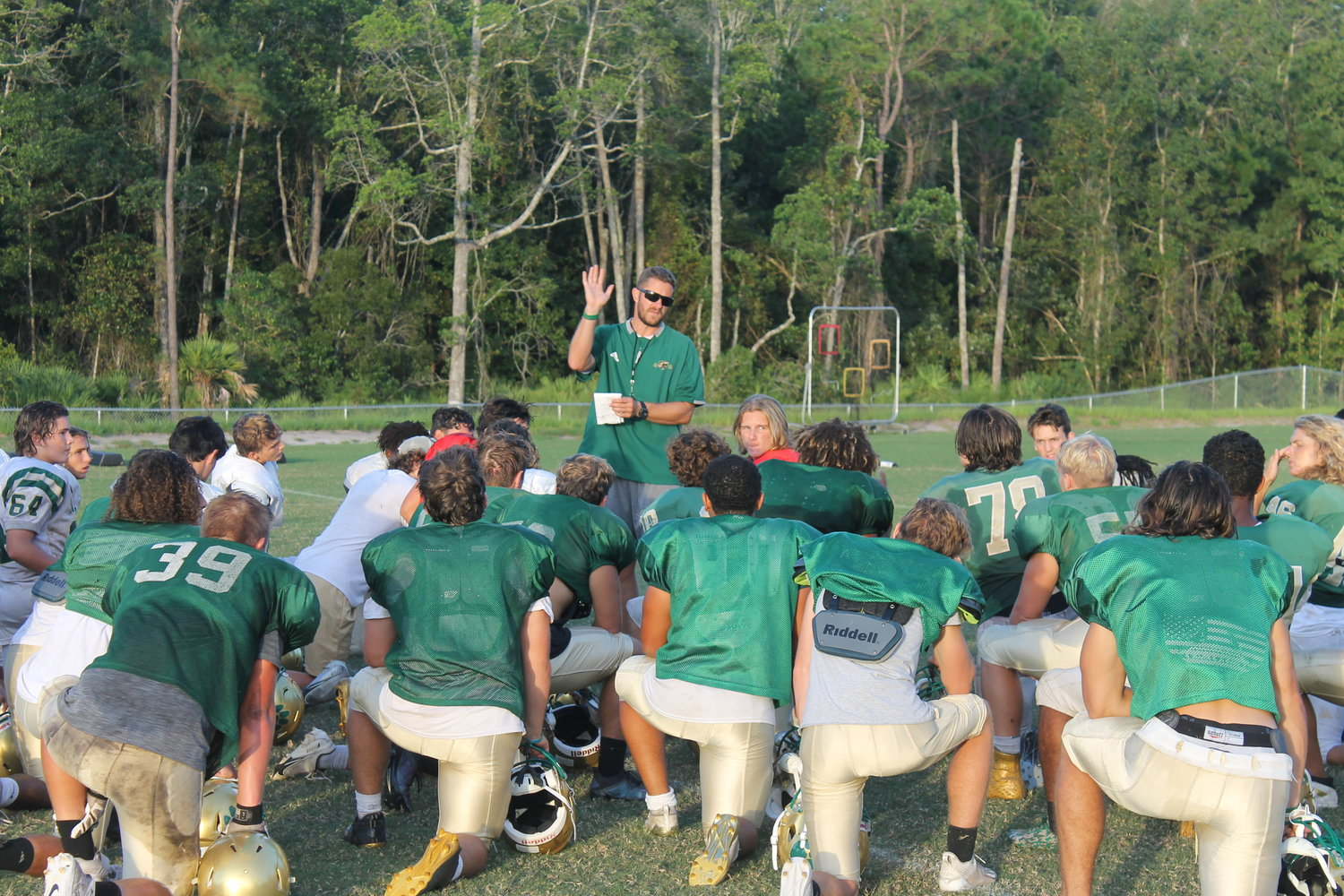 Nease coach Collin Drafts talks to his team during a recent practice.