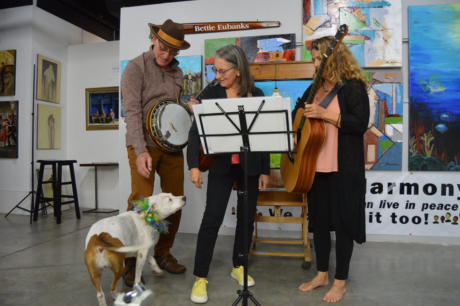 "The band Skin & Bonz turned a poem by Chris Bodor into a song and performed it in a video featuring ""Molly,"" the inspiration for smiling dog in the corresponding painting by Laura O'Neal."