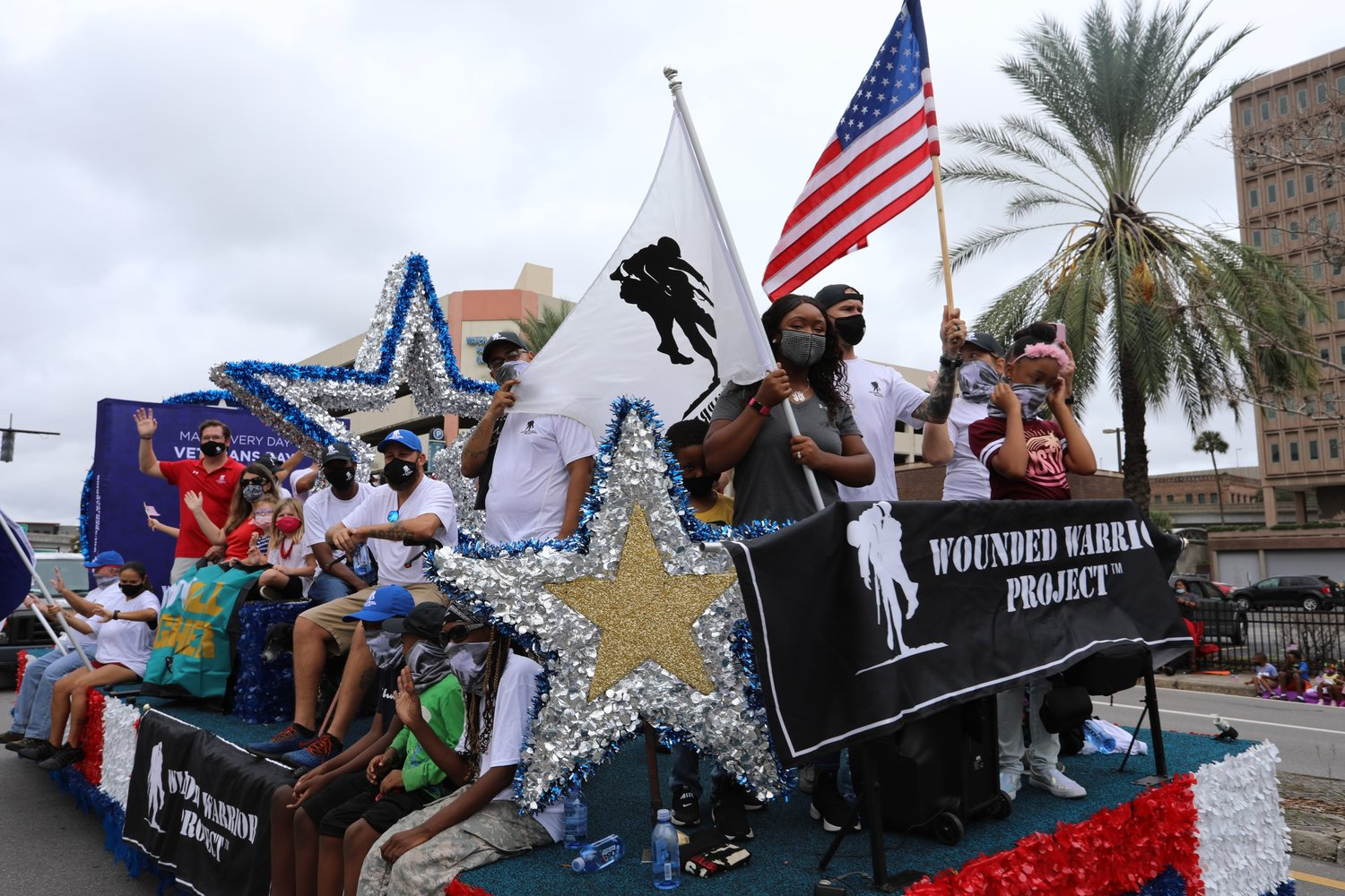 Wounded Warriors Project had a float in this year's Veterans Day parade in Jacksonville. U.S. Air Force veteran Shameka Alejandro holds a flag bearing the organization's logo at the float's front.
