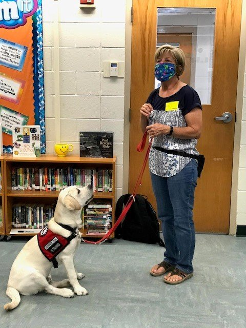 Marie Massie, a volunteer puppy-raiser for K9s For Warriors, brings service-dog-in-training Moondog to visit teacher Michelle Bettler's fifth-grade class at PVPV Rawlings.