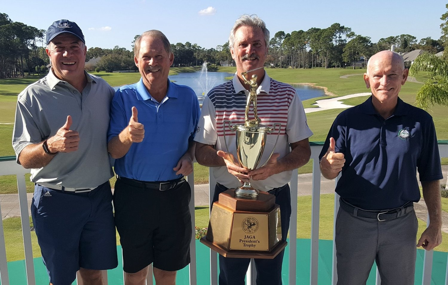 WINNING TEAM: Jacksonville Golf & Country Club team members Fermin Mendez (from left), Bill Devine, pro Ray Barr and Skip Lunsford