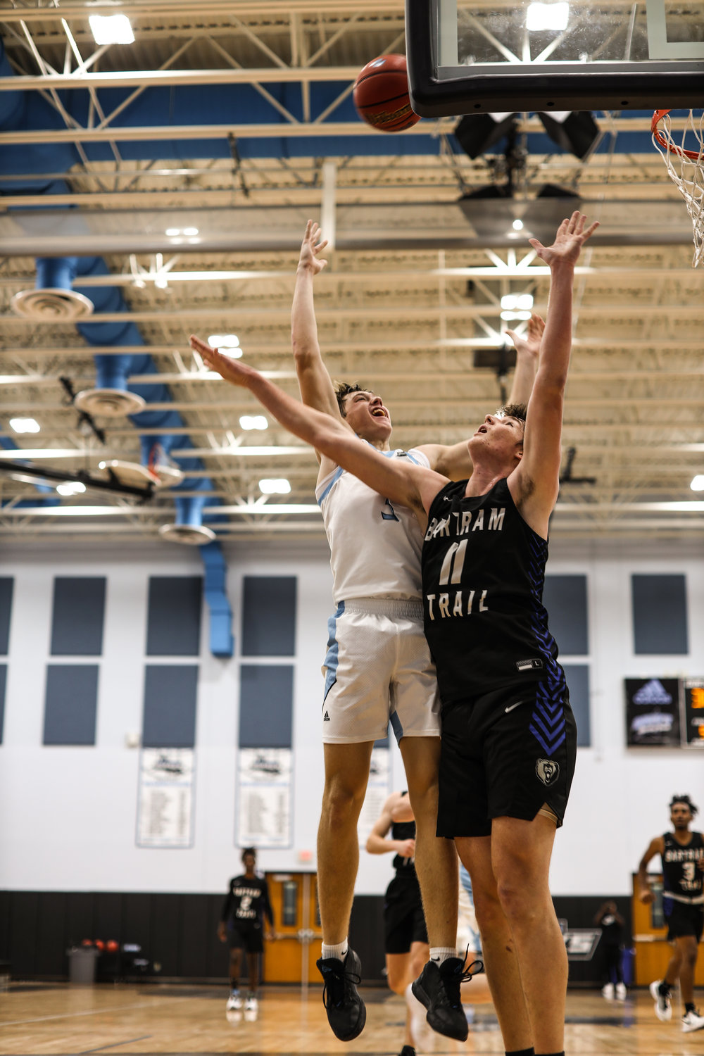 Junior Luke Pirris (left) goes up for a rebound against Bartram Trail center Alijah Kuehl last Friday.