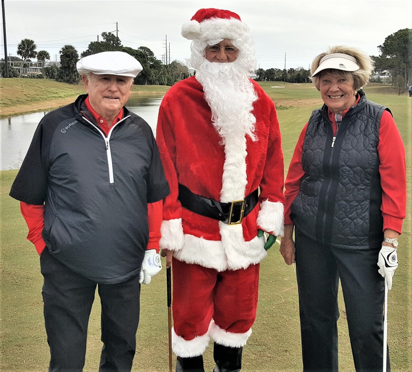 Former PGA TOUR commissioner Deane Beman and wife Judy pose with Santa at the tournament.