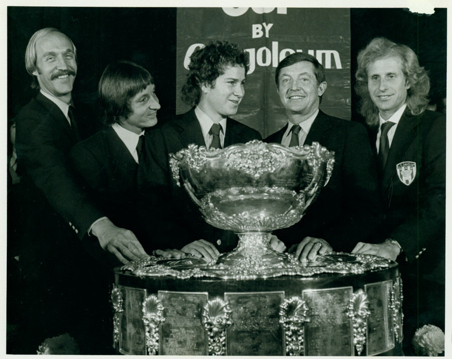 U.S. Davis Cup champions Stan Smith (from left), Bob Lutz, John McEnroe, team captain Tony Trabert and Vitas Gerulaitis pose with the Davis Cup trophy in 1979.