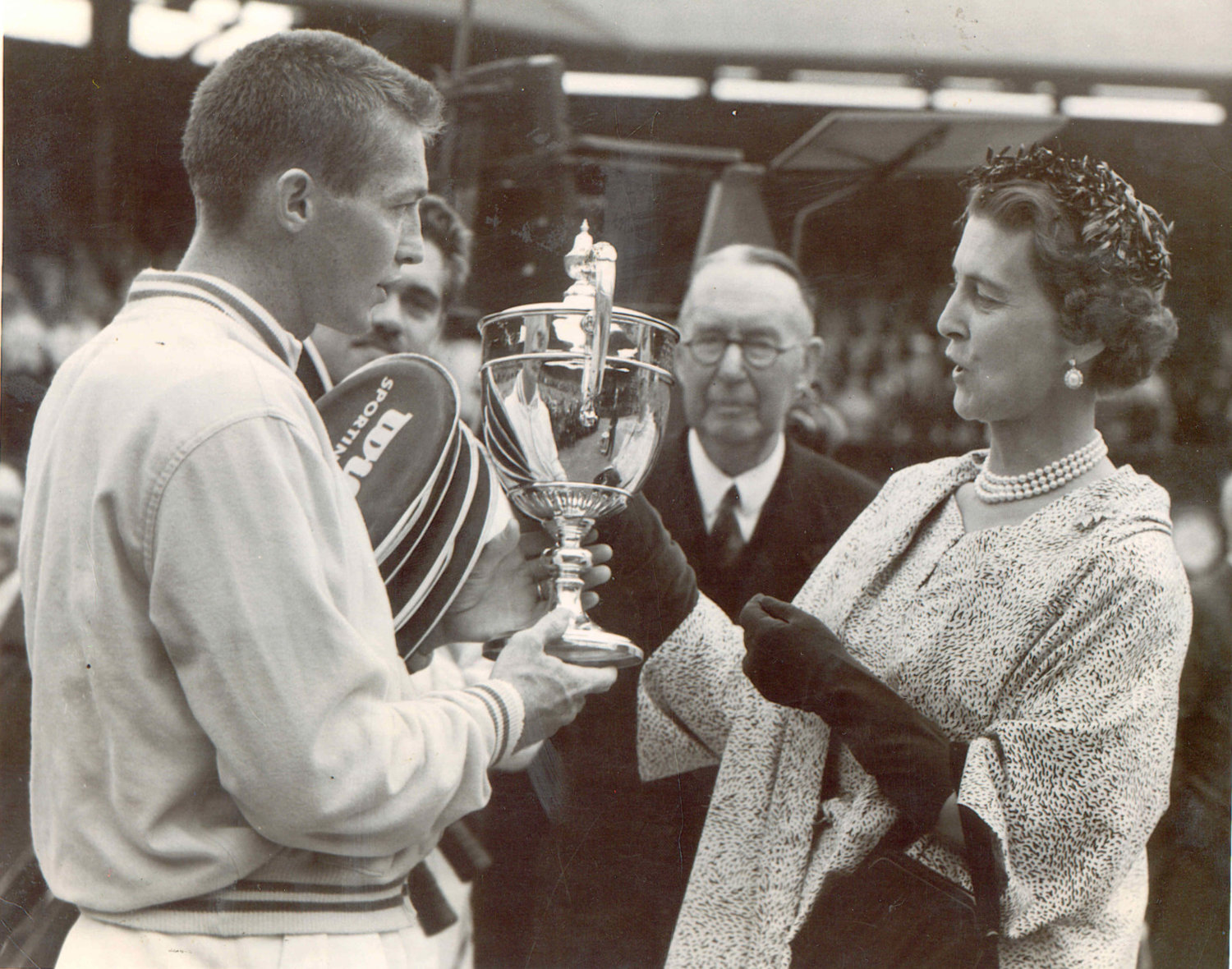 Tony Trabert is handed the Wimbledon trophy in 1955, the year he won three of four majors and was ranked No.1 in the world.