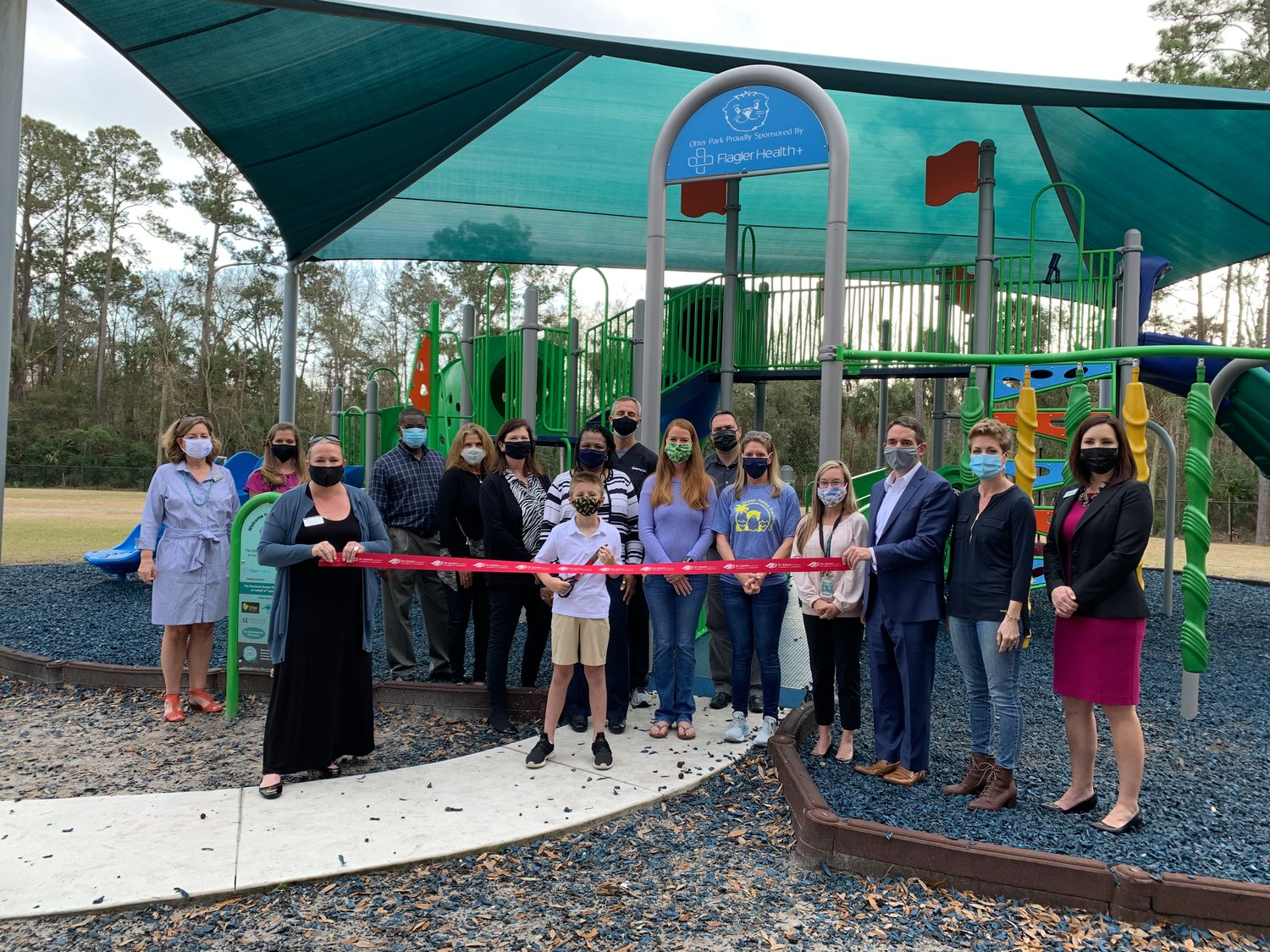 Sponsors, PTO members, administration and the Chamber of Commerce members joined in for a special ribbon-cutting ceremony to recognize the new community-funded play structure at Ocean Palms Elementary School. Third-grader Landon Hunter led the ceremony.