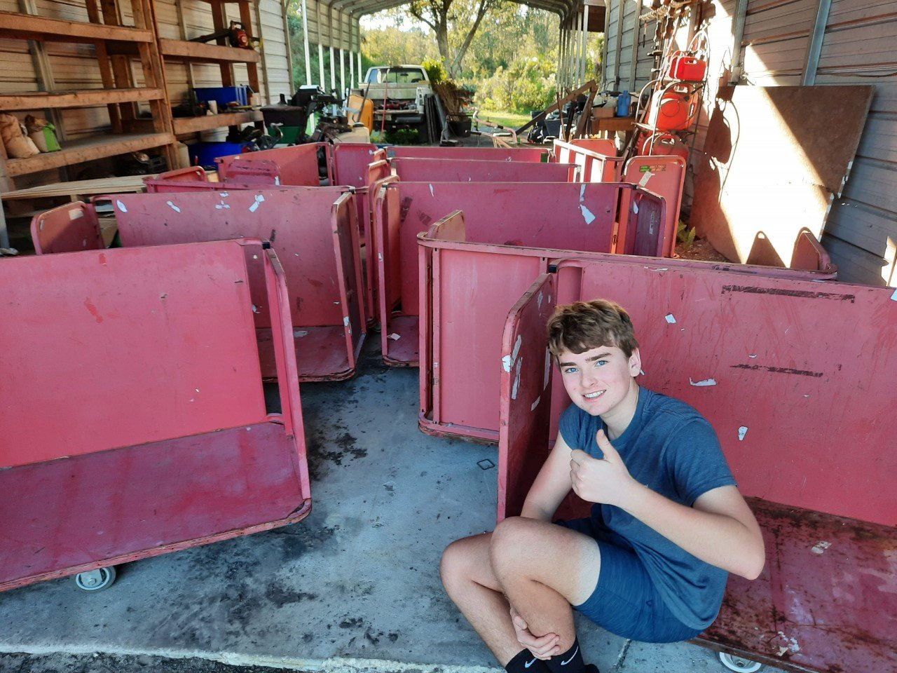 Eagle Scout Ben Black is seen with the BEAM food bank carts before they were refurbished.