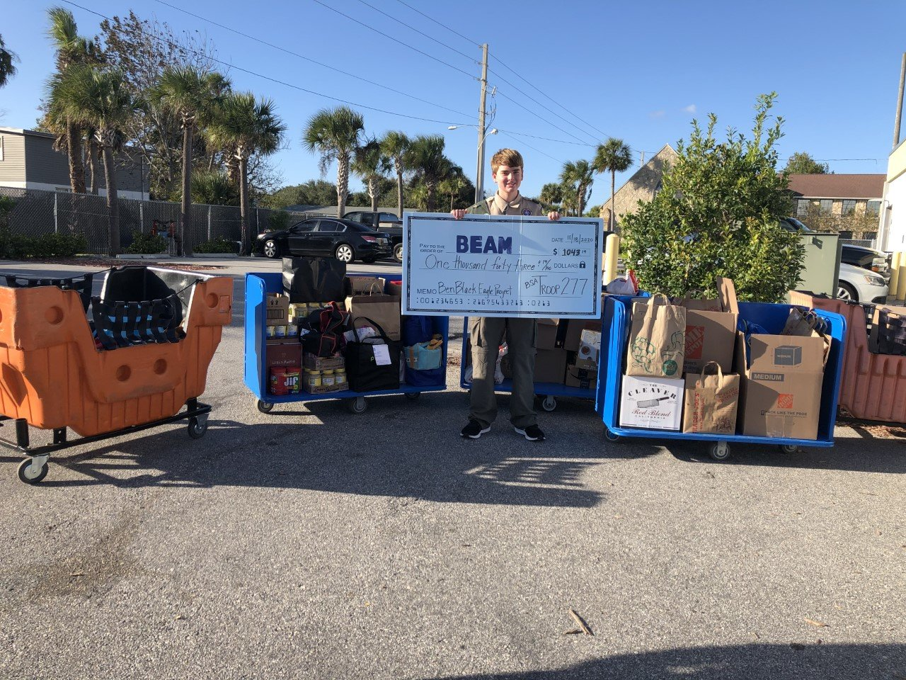 After refurbishing 17 food bank carts and collecting 920 pounds of food and toiletry items, Eagle Scout Ben Black donated more than $1,000 to BEAM.