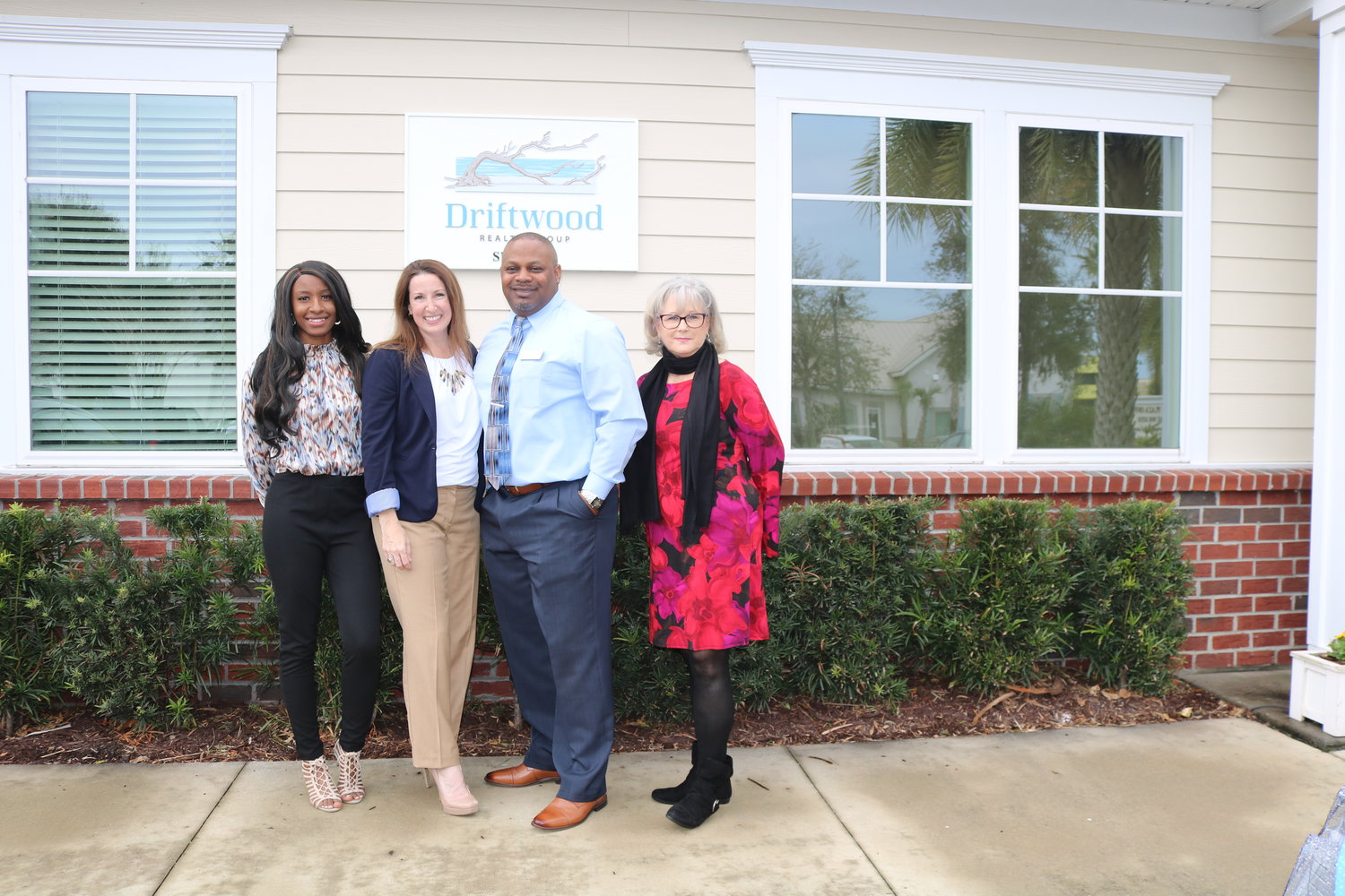 The Driftwood Realty Group team stands outside the business's offices. Pictured from left are marketing coordinator Tyra Key, business owners Kristin and Quinton Doakes, and transaction coordinator Lane Graham.