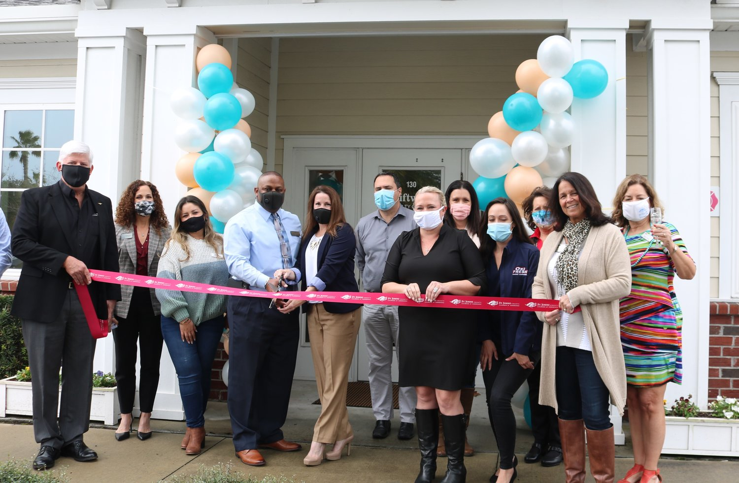 Kristin and Quinton Doakes cut the ribbon for their independent brokerage, Driftwood Realty Group.