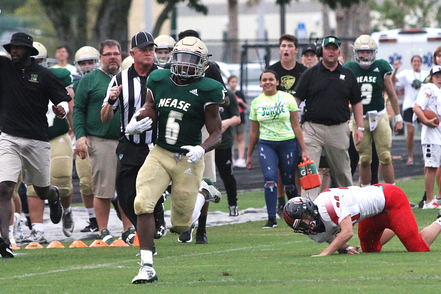 Nease running back Joe Bradshaw (6) takes off for a long touchdown run against Creekside on Aug. 30, 2019.