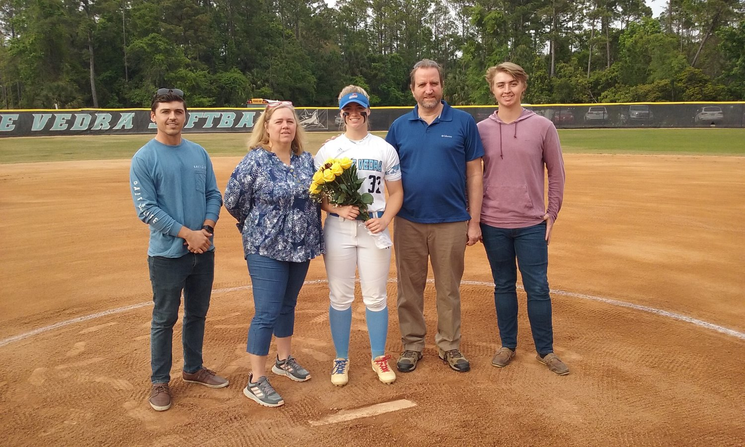 PVHS senior Tara McGee was honored recently by the Sharks women's softball team. Pictured from left are brother Kevin, mom Tammy, Tara, dad Mark and brother Cooper.