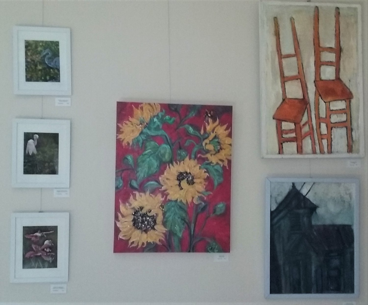 A group of artworks is seen on one wall of the rotunda.